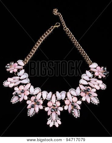 luxury pink necklace on black stand