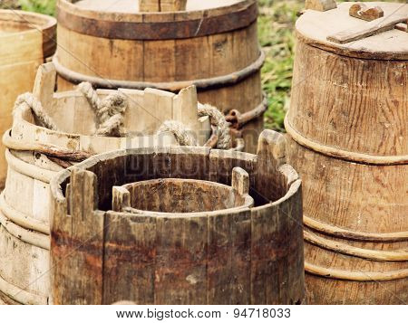 A Lot Of Old Wooden Buckets And Barrels Taken Closeup.
