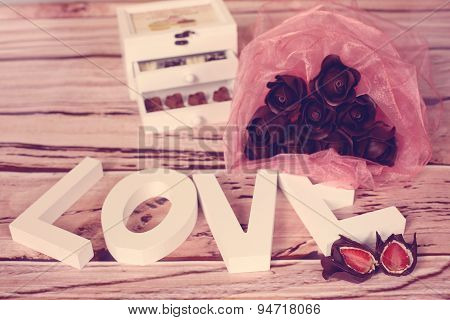 Mini Chocolate Sweets On A Festive Decor
