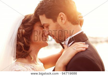 Close Up Of A Bride And Groom Embracing