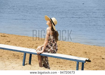 Sweet Girl On Beach With Hat