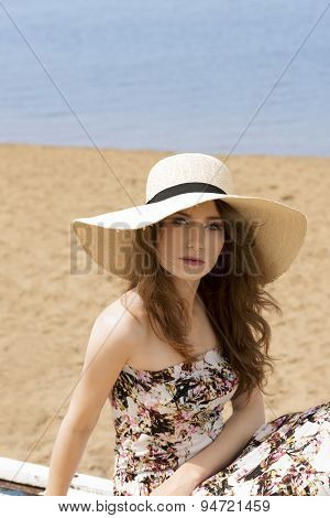 Girl In Summer Dress On The Beach