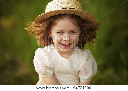 Happy Cheerful Girl In A Hat