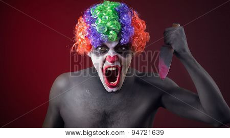 crazy clown  with a knife