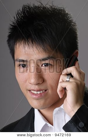 Asian Business Man Using Cellphone