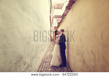 Bride And Groom On A Narrow Street
