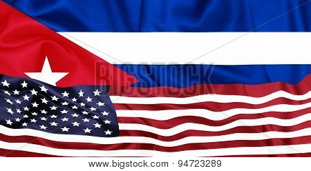 U.S and Cuba flags on silk texture