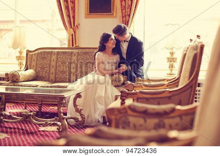 Bride And Groom In A Hotel Room