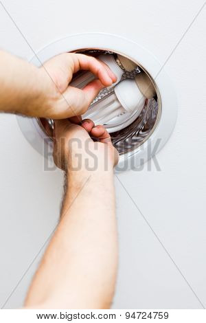Electrician Assembling Light