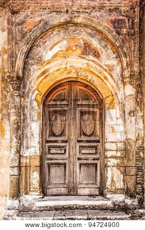 Old Closed Door With Highly Textured Doorway