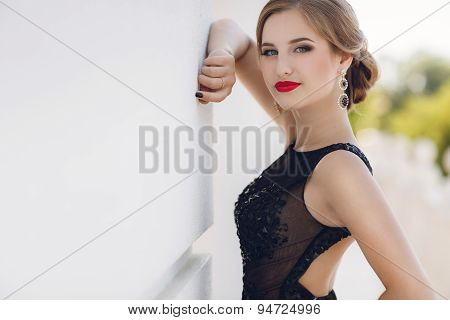 Portrait of the young beautiful smiling woman outdoors