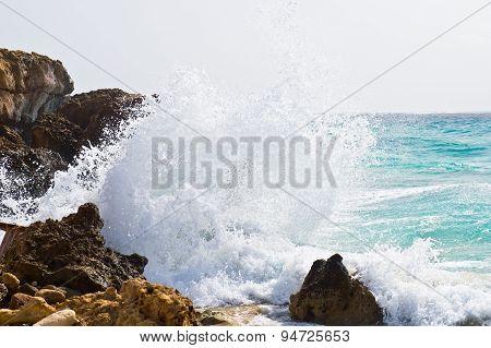 Wave crashing against the rocks