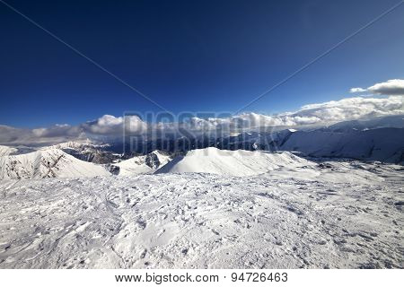 Wide-angle View On Off-piste Slope And Snowy Mountains