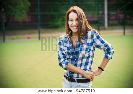 Beautiful Young Woman With Fitness Tracker On The Football Field