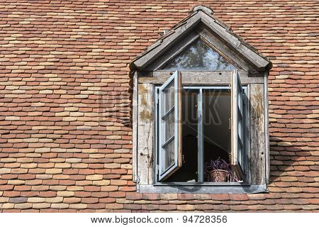 Open Window In An Old Dormer On A Roof With Historic