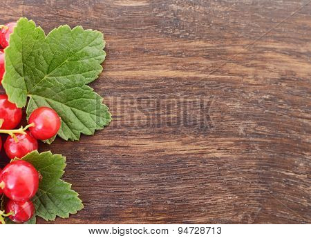 Red Currant On Old Wooden Plank