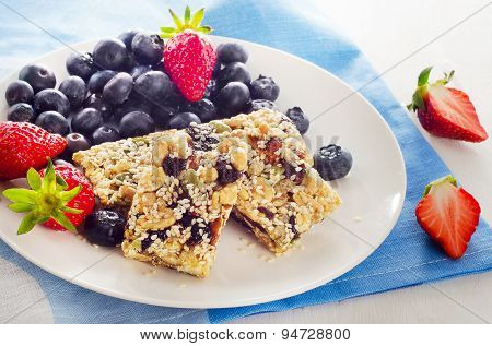 Healthy Granola Bars With Fresh Berries For Breakfast.