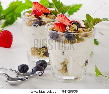 Granola With Yogurt And Fresh Berries In Glasses.