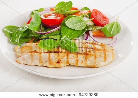 Fresh Salad With Grilled Chicken On A White Plate.