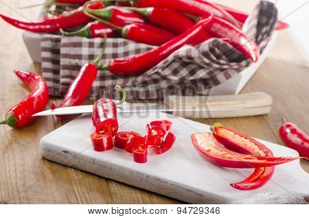 Red Chili Peppers On  A Wooden Table.