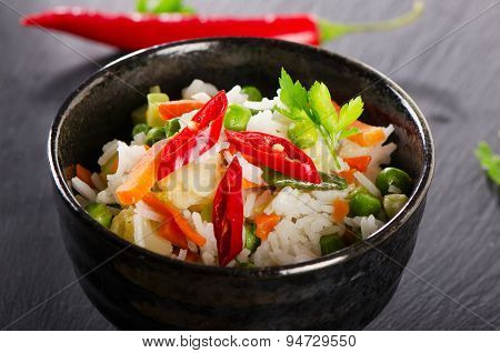 Rice And  Vegetables On  Black Table.