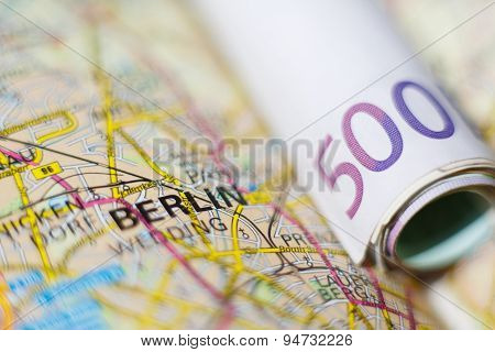 Euro Banknotes On A Geographical Map Of Berlin