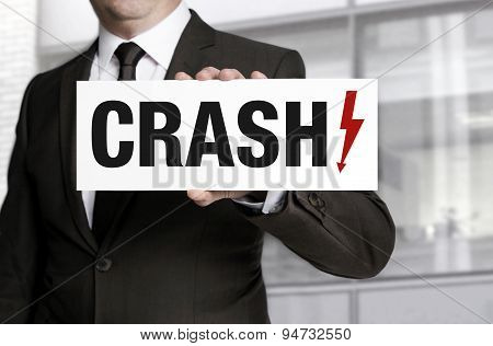 Crash Sign Is Held By Businessman