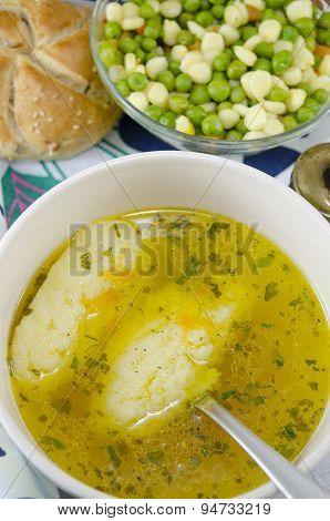 Bowl Of Soup With Noodles And Plate Of Vegetables