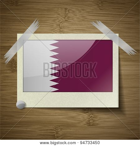 Flags Qatar At Frame On Wooden Texture. Vector