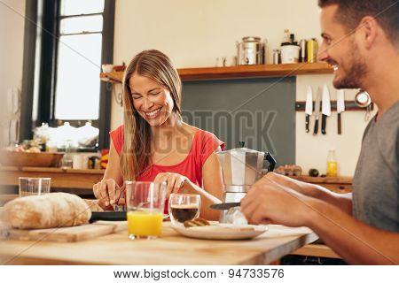 Happy Young Couple Having Breakfast Together