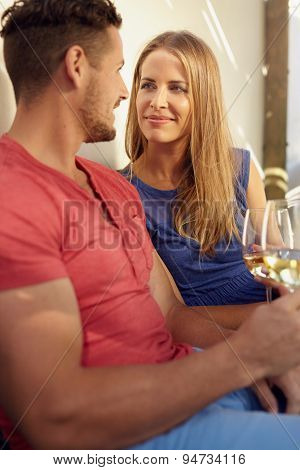 Couple With Wine Looking At Each Other Romantically