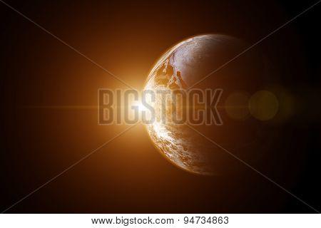 Earth with sunrise flare.