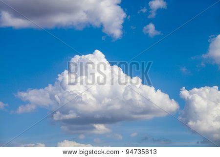 Puffy Cloud Against A Deep Blue Sky