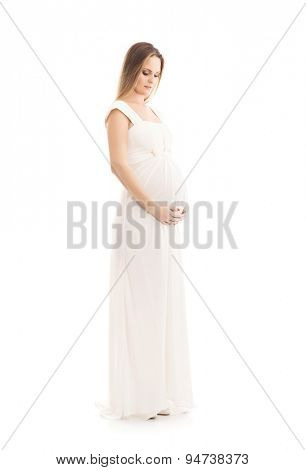 Young and beautiful pregnant woman in antique dress over grey background with a lot of blank space