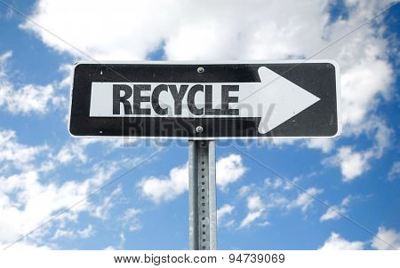 Recycle direction sign with sky background