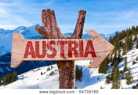Austria wooden sign with alps landscape