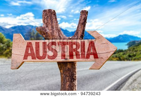 Austria wooden sign with road background