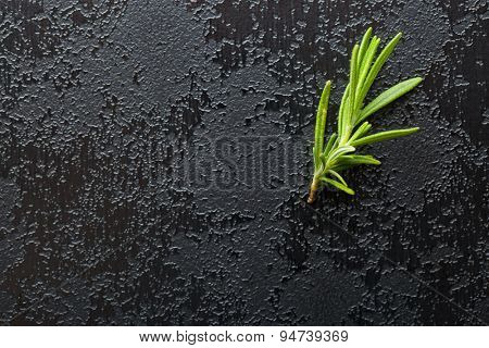 rosemary branch on black table