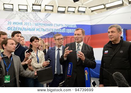 ST. PETERSBURG, RUSSIA - JUNE 20, 2015: General director of JSC Rosseti Oleg Budargin (center) talks with press during the presentation of the project of Federal Test Center for electrical equipment