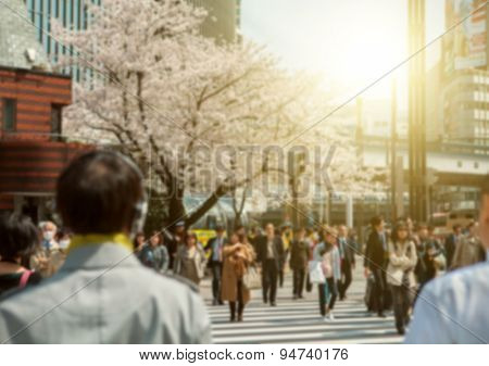 People in bokeh, street downtown view of  Tokyo.