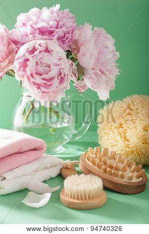 bath and spa with peony flowers brush sponge towels