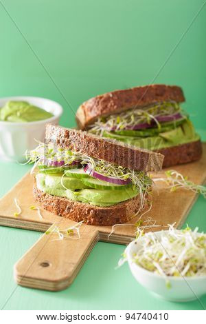 healthy rye sandwich with avocado cucumber alfalfa sprouts