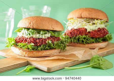 vegan beet and quinoa burger with avocado dressing