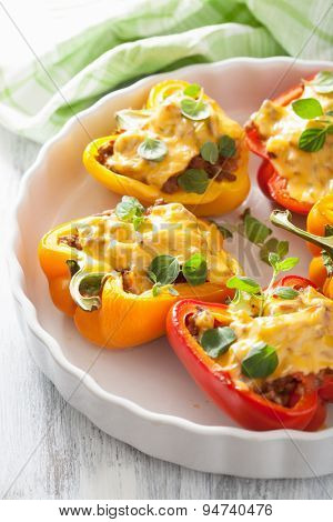 stuffed colorful peppers with meat cheese vegetables