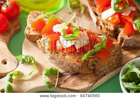 italian bruschetta with tomatoes parmesan arugula