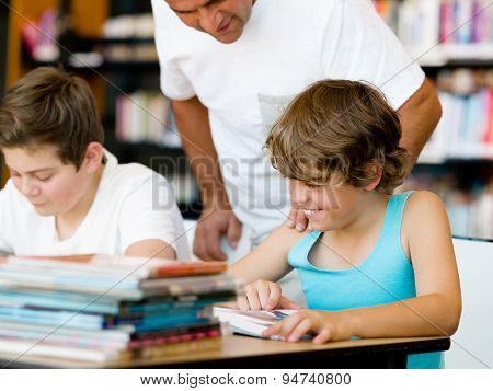 Two boys in library with books