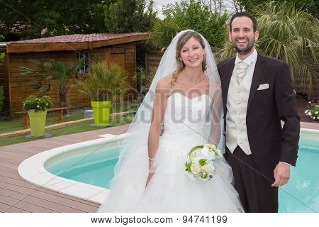 Happy Married Couple Near A Swimming Pool