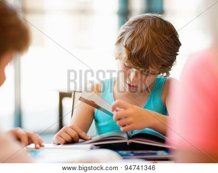 Boy in library with books