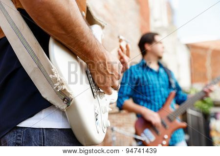 A street musician playing his guitar