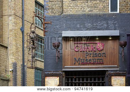 LONDON, UK - JUNE 23: Entrance to The Clink prison museum, which exhibits medieval torture tools, with replica of skeleton in cage. June 23, 2015 in London.